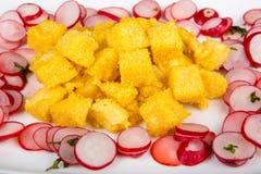 Fried polenta with fresh radishes. Salad Stock Images