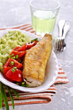 Fried  pollock with vegetables Stock Images