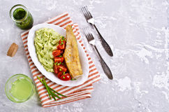 Fried  pollock with vegetables Royalty Free Stock Photos