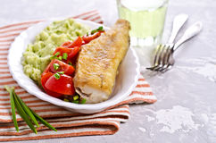Fried  pollock with vegetables Royalty Free Stock Photography