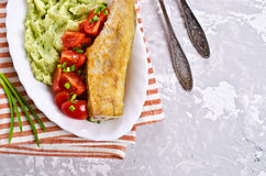Fried  pollock with vegetables Royalty Free Stock Photo