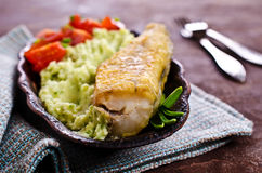 Fried  pollock with vegetables Royalty Free Stock Image