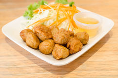 Fried pork ball  with sauce Royalty Free Stock Photography