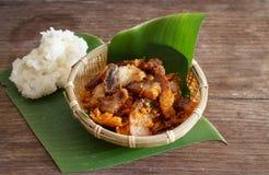Fried pork belly with sticky rice. Stock Image