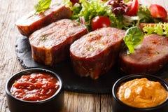 Fried pork brisket and fresh salad, ketchup and mustard. horizon stock photo