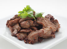 Fried pork with celery leaves Stock Image