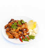 Fried pork with chili pepper,garlic and ginger. Fried pork with chili pepper,garlic and ginger on plate Stock Images