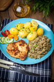Fried pork chop, baked potatoes and fried young cabbage. Stock Image