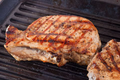 Fried pork chop on the cast iron Grill Stock Image