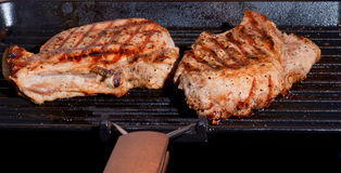 Fried pork chop on the cast iron Grill Royalty Free Stock Photo