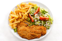 Fried pork chop and French fries Stock Image