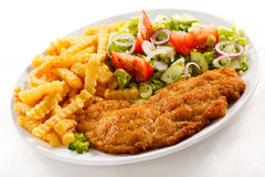 Fried pork chop and French fries Stock Photos