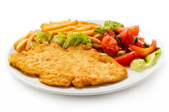 Fried pork chop and French fries Royalty Free Stock Images