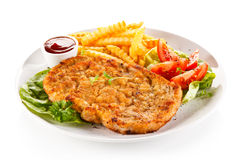 Fried pork chop and French fries Stock Photo