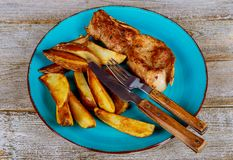 Fried pork chop and french fries on background stock photo