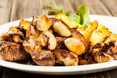 Fried pork chop with mushrooms Stock Images