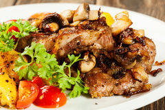 Fried pork chop with mushrooms Royalty Free Stock Image