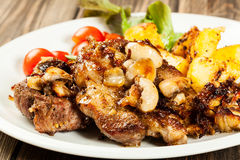 Fried pork chop with mushrooms Royalty Free Stock Photography