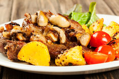 Fried pork chop with mushrooms Stock Photos