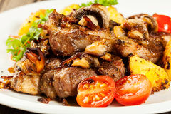 Fried pork chop with mushrooms Stock Photos