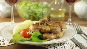 Fried pork chop with mushrooms stock video footage