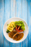 Fried pork chop, puree and vegetables Royalty Free Stock Photos
