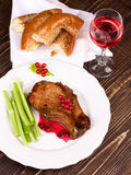 Fried pork chop with red currant sauce Royalty Free Stock Photos