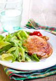 Fried pork chop and salad Stock Image
