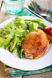 Fried pork chop and salad Stock Photography