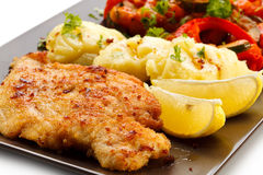 Fried pork chop and vegetables Stock Photos