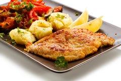 Fried pork chop and vegetables Stock Images