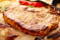 Fried pork chop on a wooden board Stock Images
