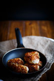 Fried pork chops in a frying pan Royalty Free Stock Photos
