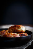 Fried pork chops in a frying pan Royalty Free Stock Image