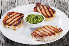 Fried pork chops marinated with pesto sauce Royalty Free Stock Image