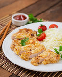 Fried pork cutlet with fresh cabbage salad Stock Photography