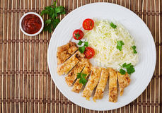 Fried pork cutlet with fresh cabbage salad and sauce. Royalty Free Stock Images