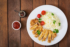 Fried pork cutlet with fresh cabbage salad and sauce. Stock Photo