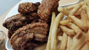 Fried Pork et puces Photos stock