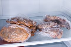 Fried pork fillet in a refrigerator. Ready meals. Fried pork fillet in a refrigerator Stock Photo
