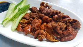 Fried pork intestines serve withvegetable. Fried pork intestines serve with vegetable Stock Photo