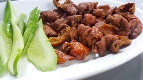Fried pork intestines serve withvegetable. Fried pork intestines serve with vegetable Stock Image