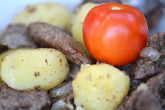 Fried pork liver with tomatoes and potatoes Stock Photos