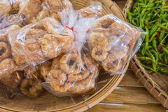 Fried pork, local food of Chiang Mai. Fried pork skin snack in plastic bag one of the local food of Chiang Mai, is a famous souvenir royalty free stock images
