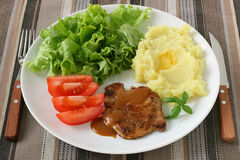 Fried pork with mashed potato Stock Photos