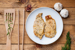 Fried pork meat, spatula and tongs. Photography of a fried pork meat, spatula and tongs Stock Photo