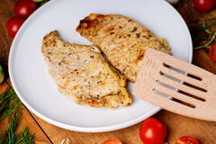Fried pork meat and spatula. On a wooden background Royalty Free Stock Photo