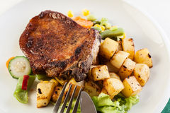 Fried pork with potatoes and vegetables salad Royalty Free Stock Photography
