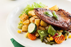 Fried pork with potatoes and vegetables salad Stock Photos