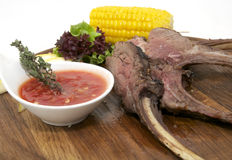 Fried pork ribs with sauce. And corn on a white background Royalty Free Stock Image